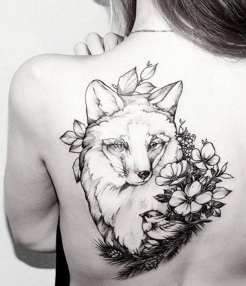 beautiful black and white fox tattoo