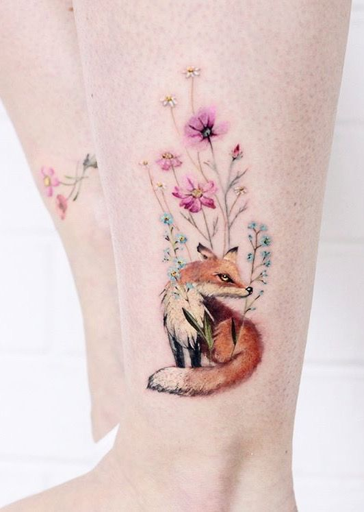 flowers and fox tattoo