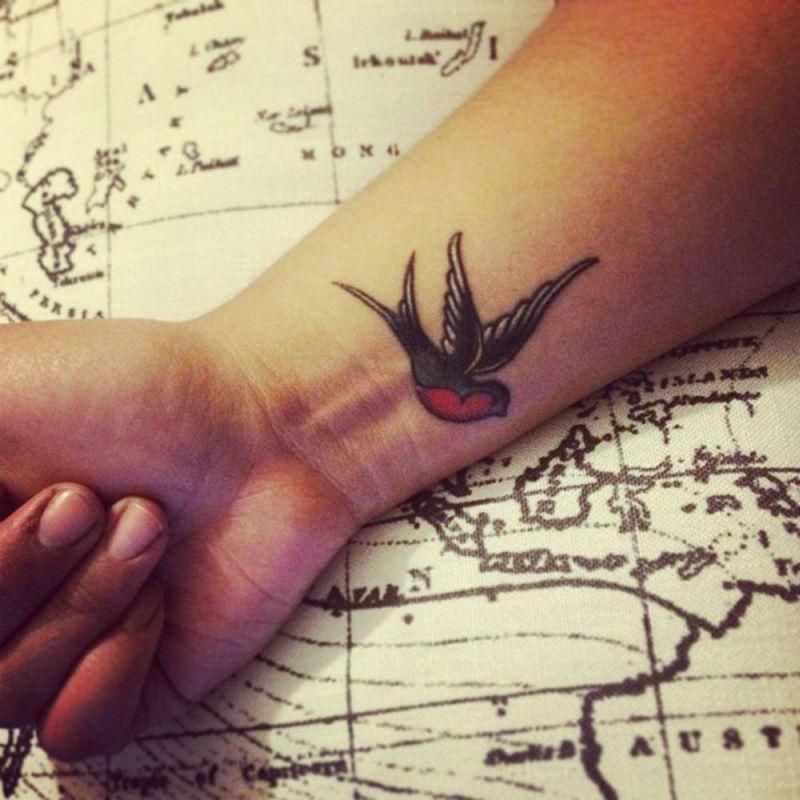 Small Small swallow tattoo hand