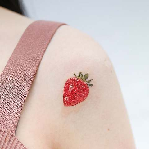 realistic strawberry tattoo
