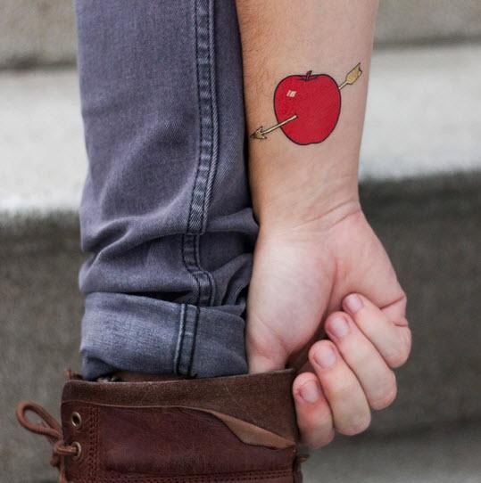 red apple arrow tattoo
