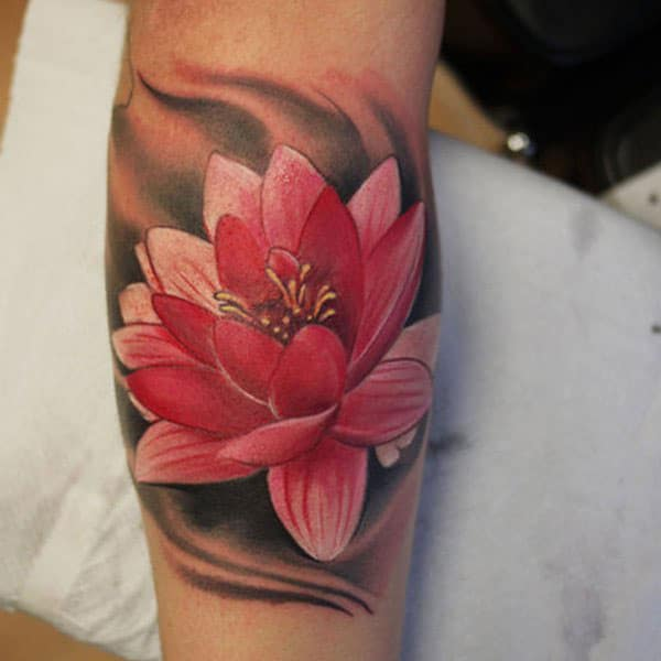 red lotus flower tattoo arm