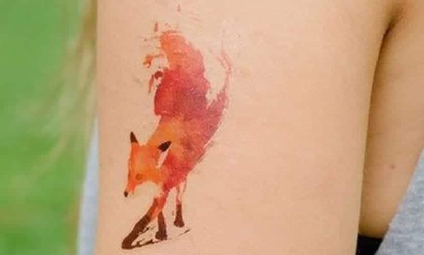 watercolor silhouette fox tattoo