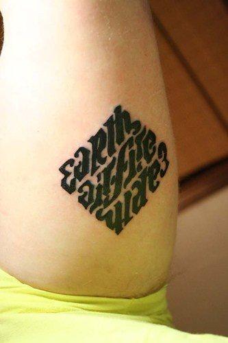 Fire Water Earth Air ambigram tattoo