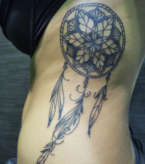 dreamcatcher tattoo on ribs