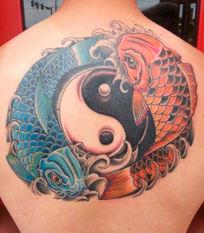 Traditional yin yang Pisces tattoo