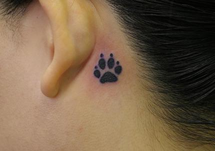 ear dog paw tattoo