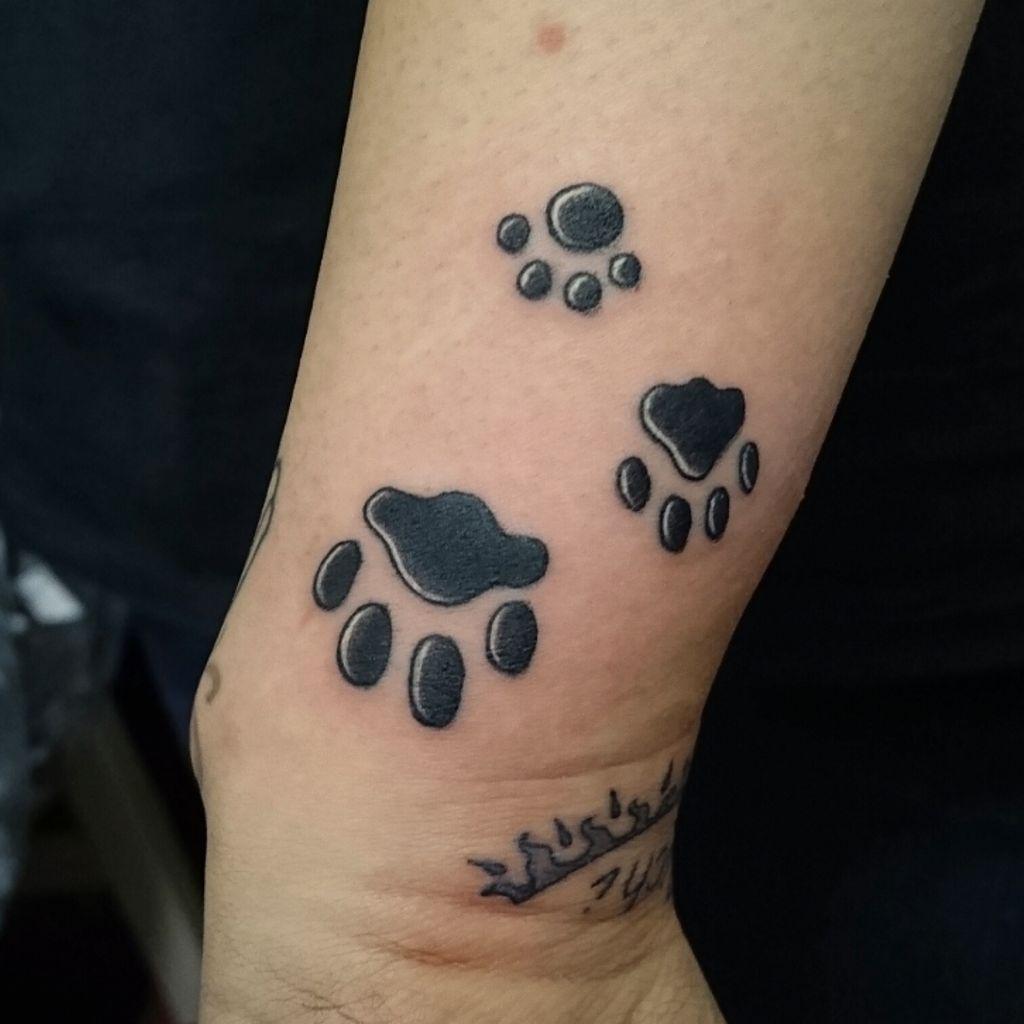 cat paw prints tattoo