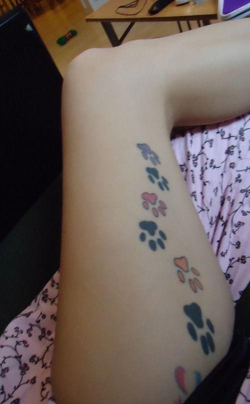 leg paw prints tattoo